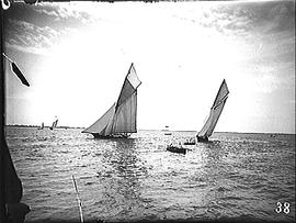 [Two Sailboats and Two Row Boats]