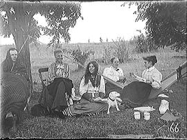 [Four Women, a Man and a dog with a Hammock]